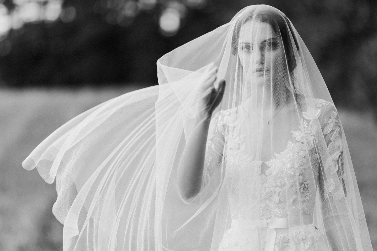 black and white bride with cathedral veil