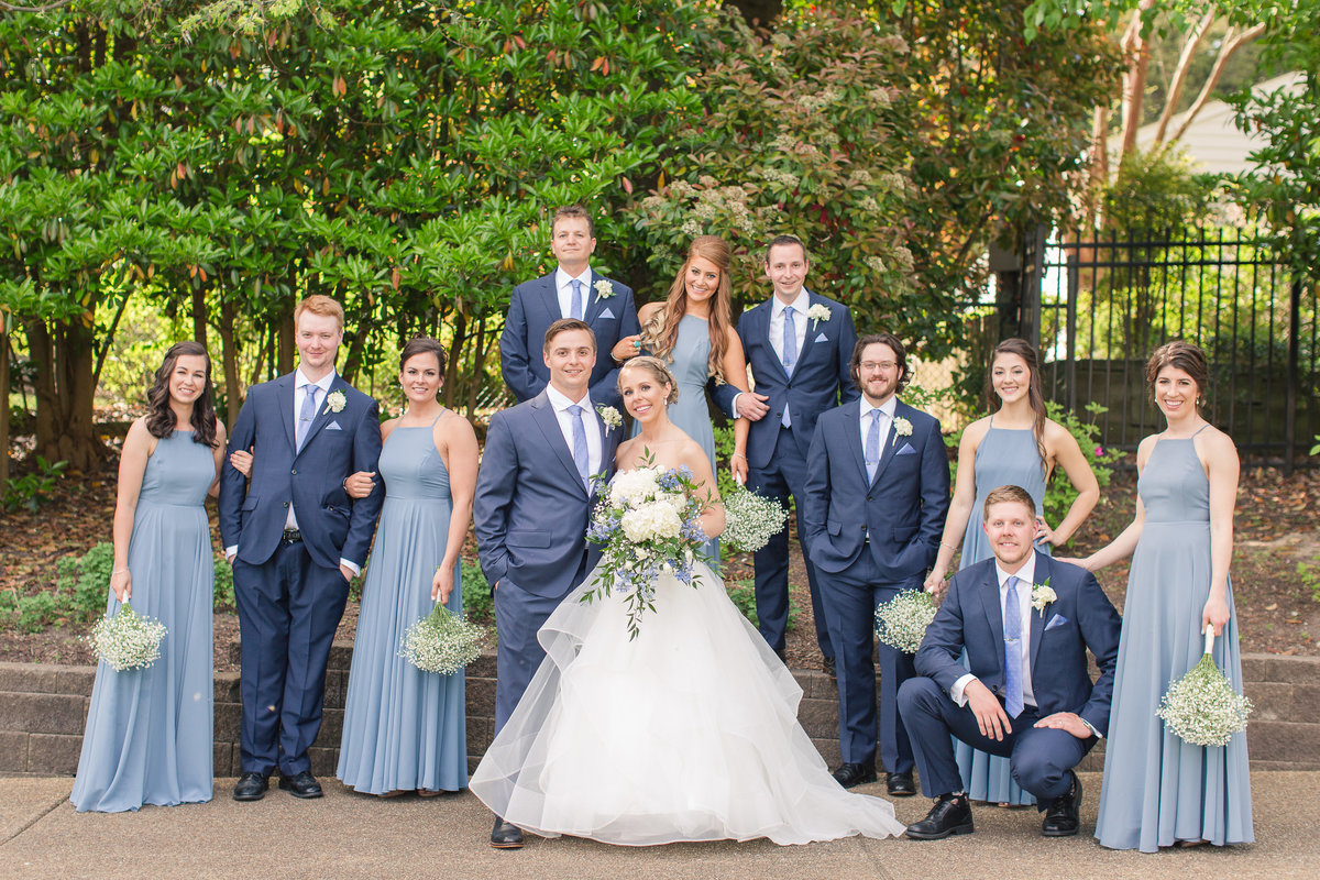 beautiful bridal party in blue dresses and blue suits at James River Country Club