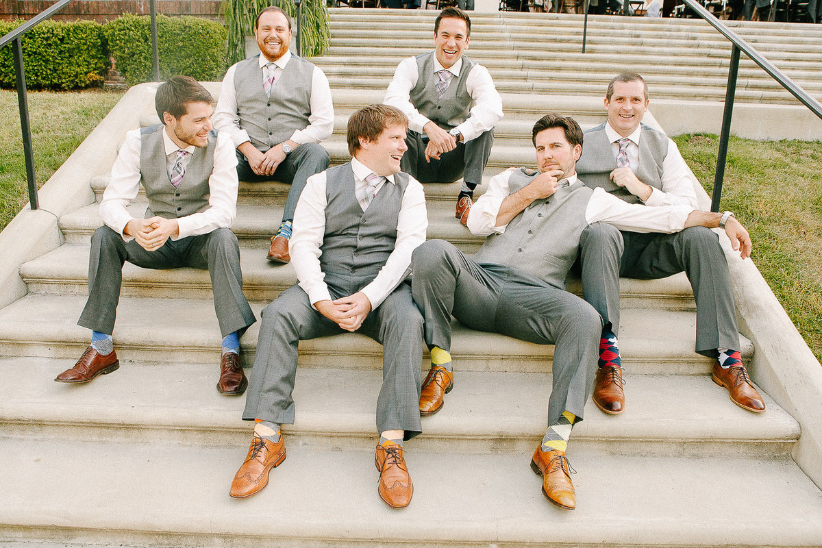 A casual wedding party photograph of a groom and his goomsmen at Villa Montalvo.