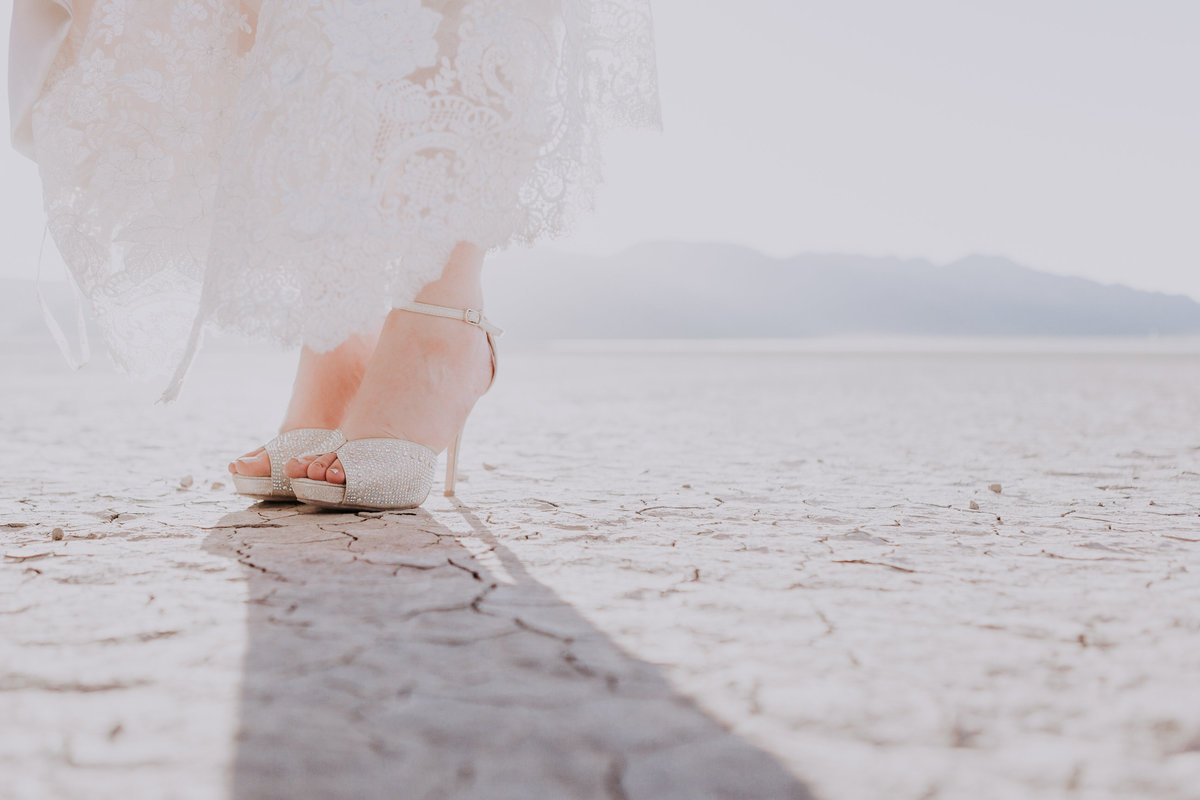 Lake Tahoe elopement pictures bride's shoes on cracking desert playa