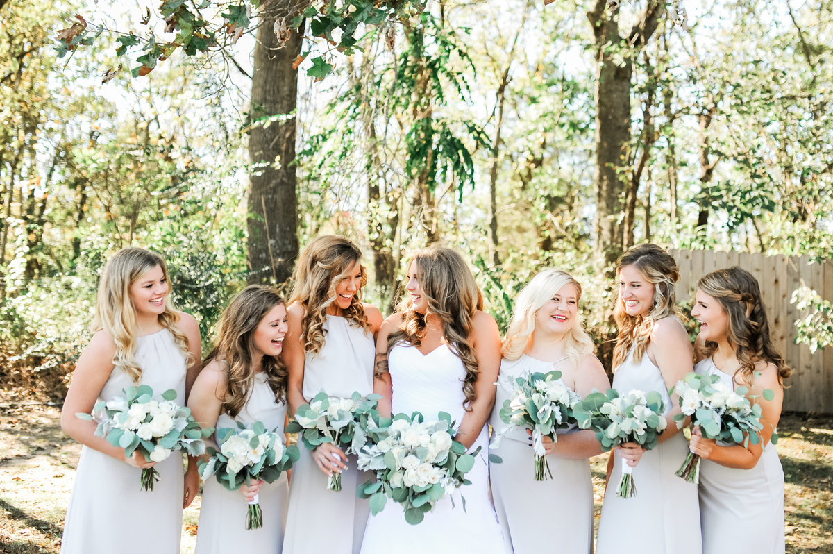 Stone Chapel at Matt Lane Farm Fayetteville wedding  Bride and her bridesmaids in elegant pale grey bridesmaid dresses with all white neutral floral bouquets taken by Northwest Arkansas Wedding Photographer Christy Simply Bliss Photography