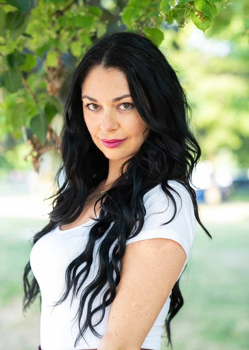 headshot of a woman with long black hair