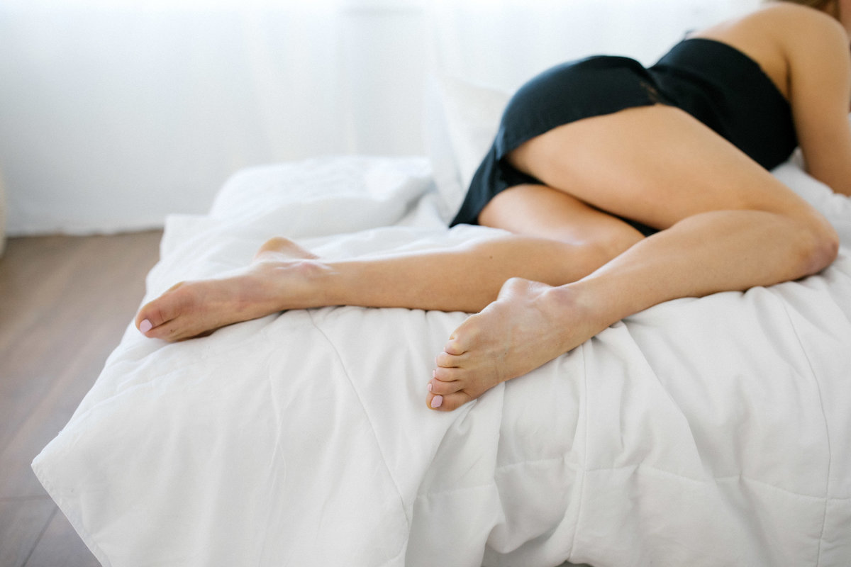 Woman laying on a bed