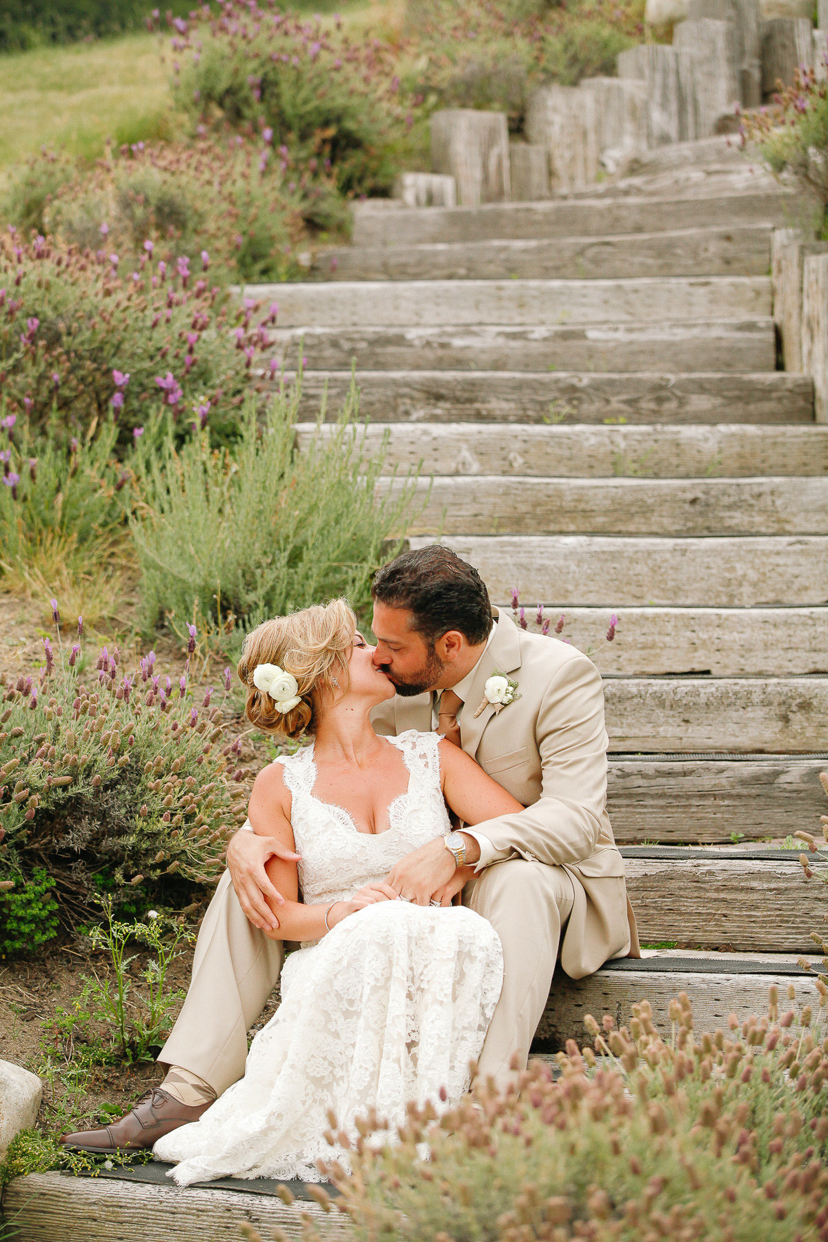 A bride and groom share a kiss at the Carmel Valley Ranch wedding.