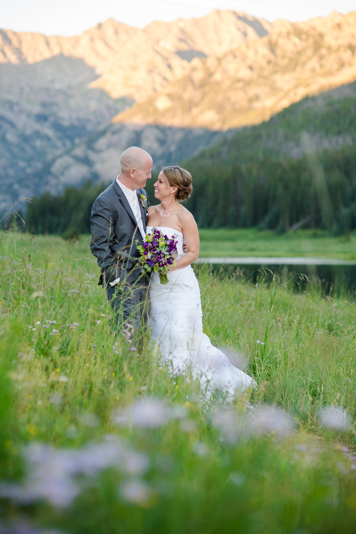 wedding couple in Colorado wildflowers