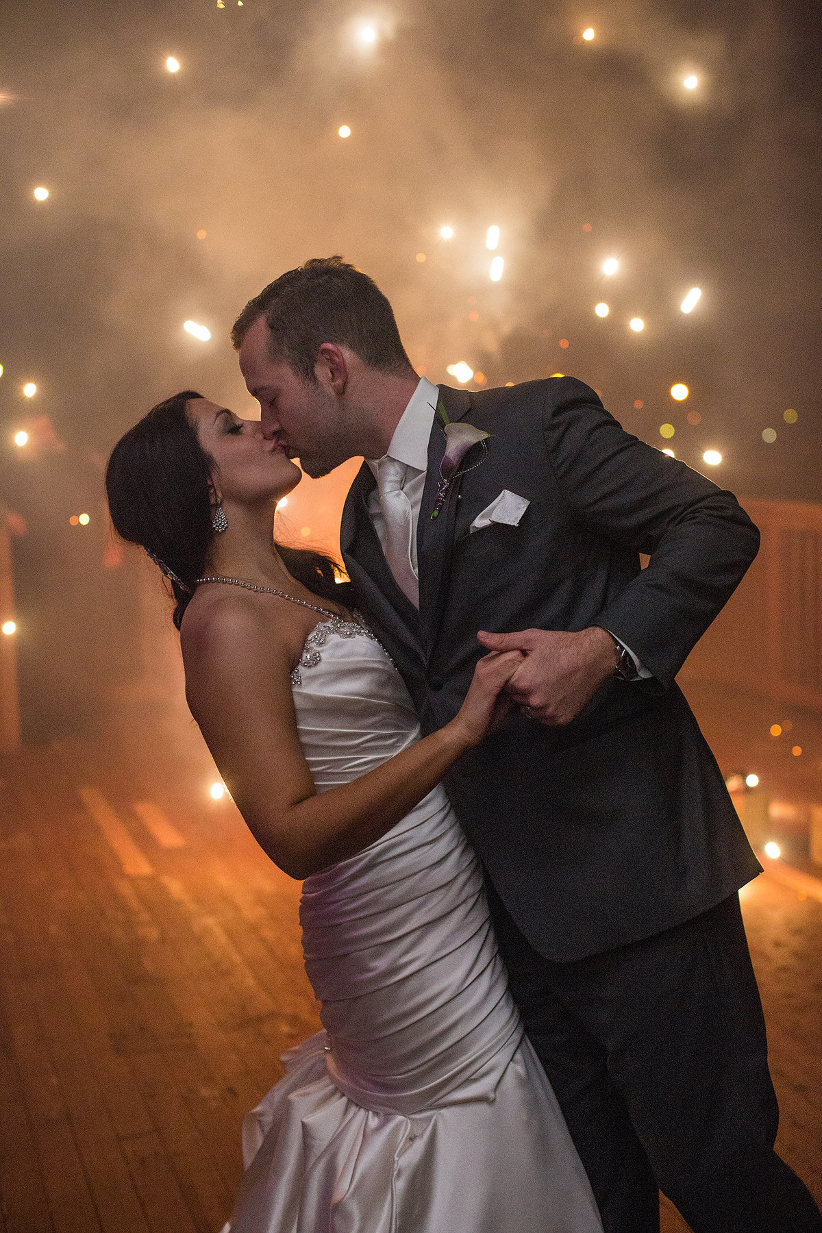 new years eve wedding fireworks with couple kissing