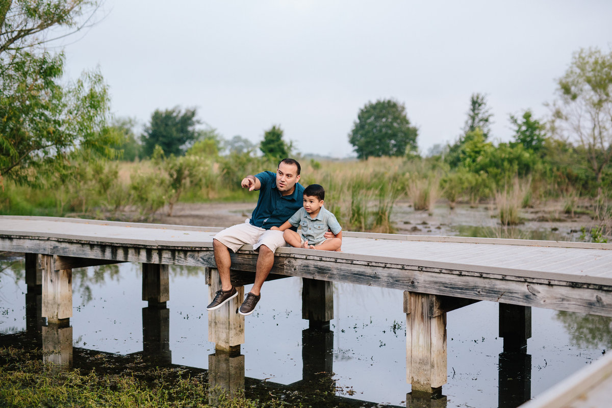 father and son on pier for portrait session by San Antonio photographer Expose The Heart