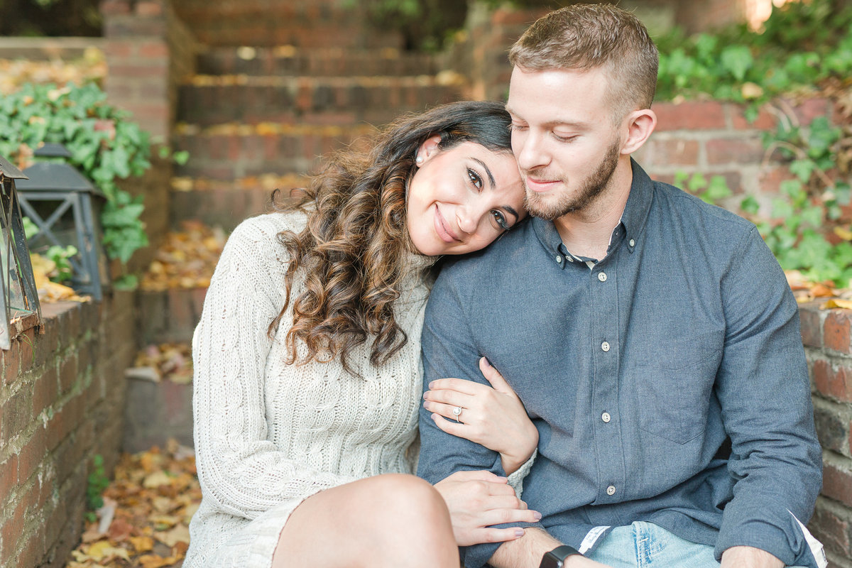 A couple posing in Old Town Alexandria for an engagement photoshoot.