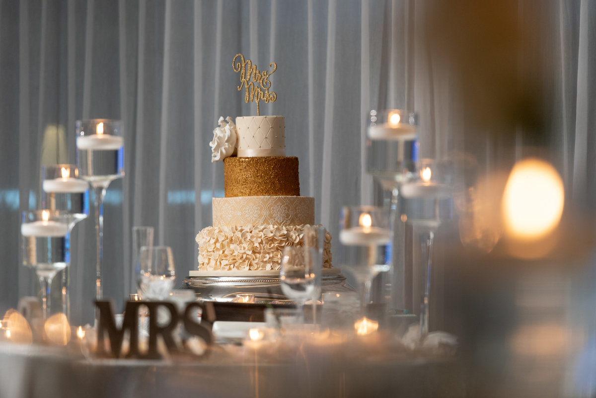 Gold and white wedding cake at Harbor Club at Prime