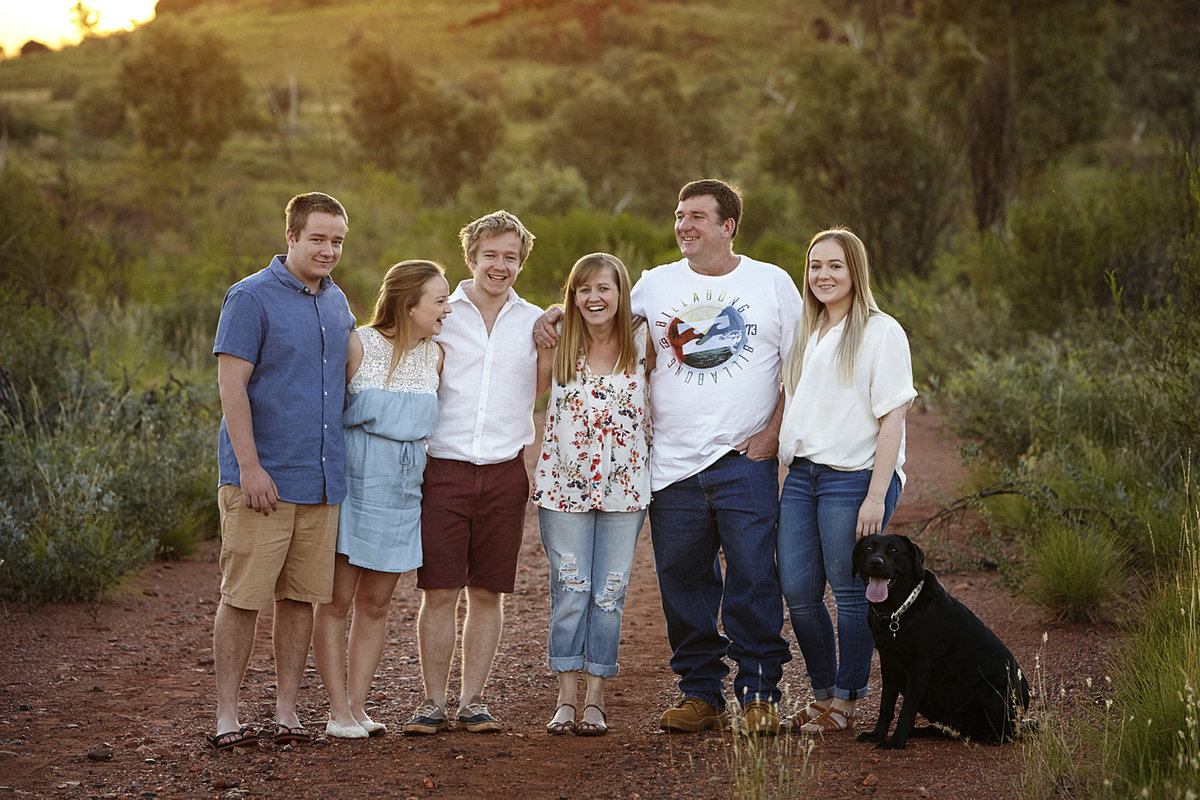 Family of 6 with a black lab in natural bushland with golden sunlight