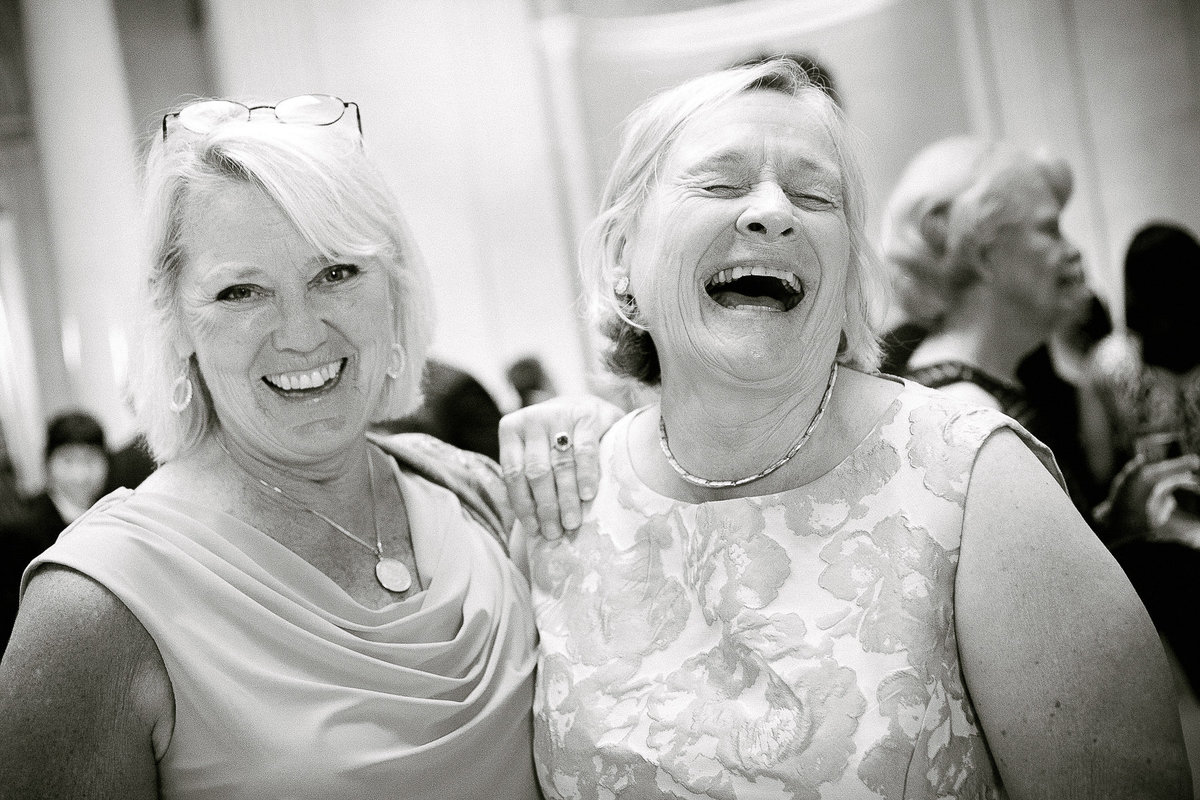 Mother of the bride laughing.