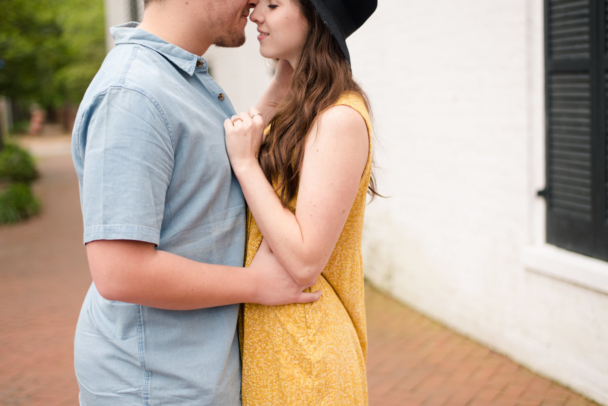 couple kisses in downtown norfolk  virginia engagement session by norfolk photographer