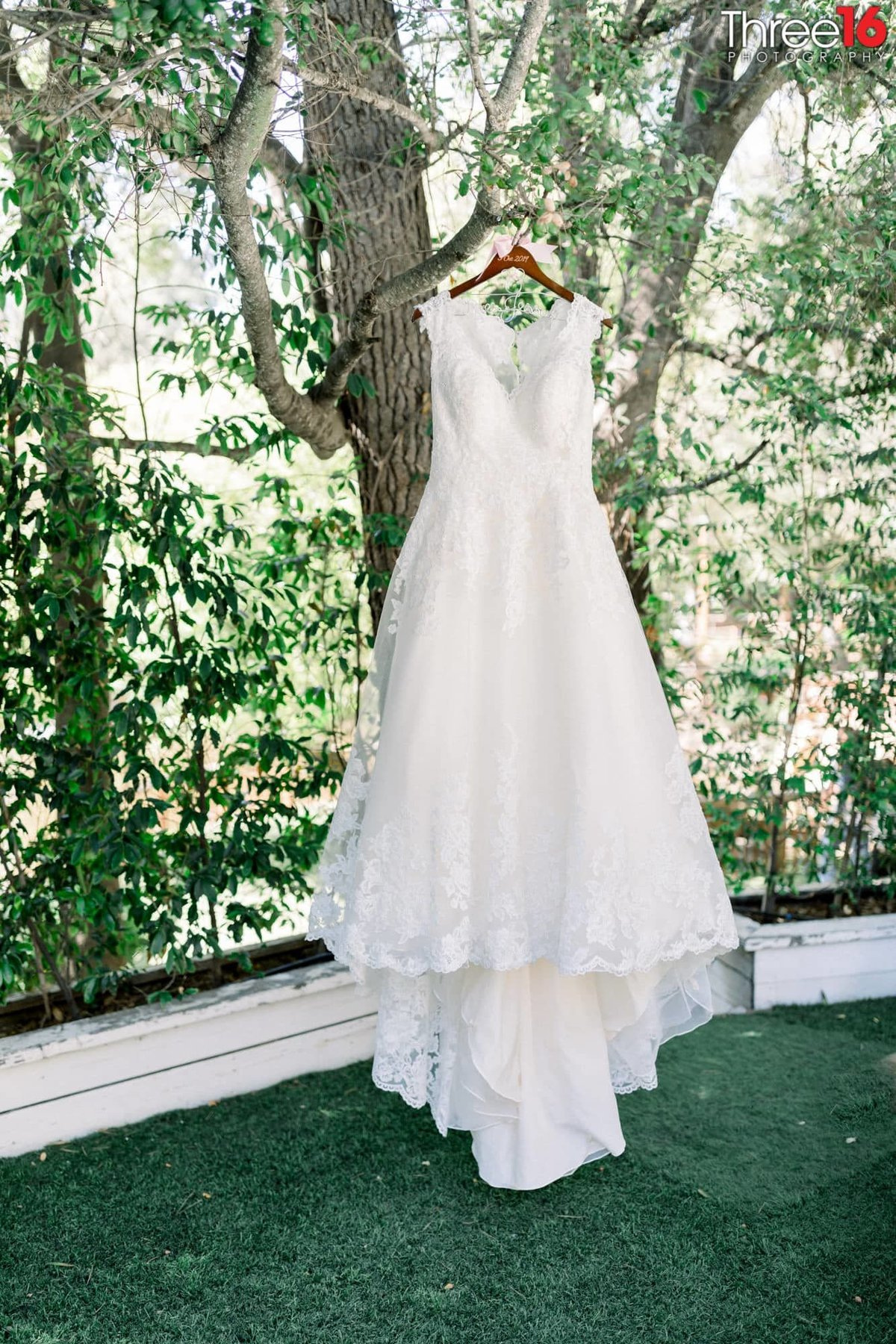 Wedding gown hanging from a tree at Calamigos Ranch in Malibu, CA