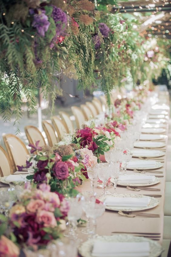 Outdoor wedding tablescape purple and pink decor
