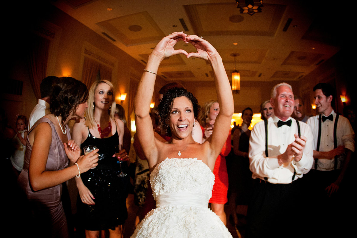Bride holding heart in air