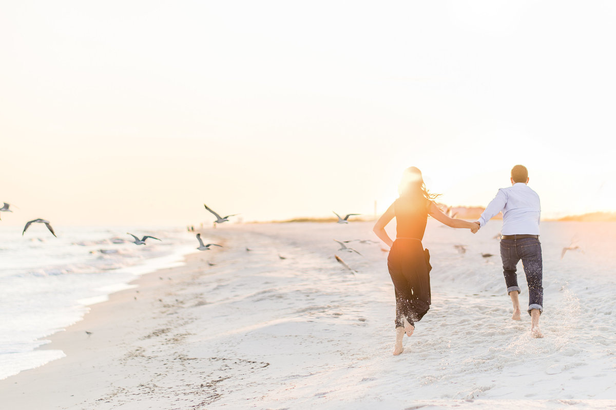 Destin, Florida beach engagement session running through the birds