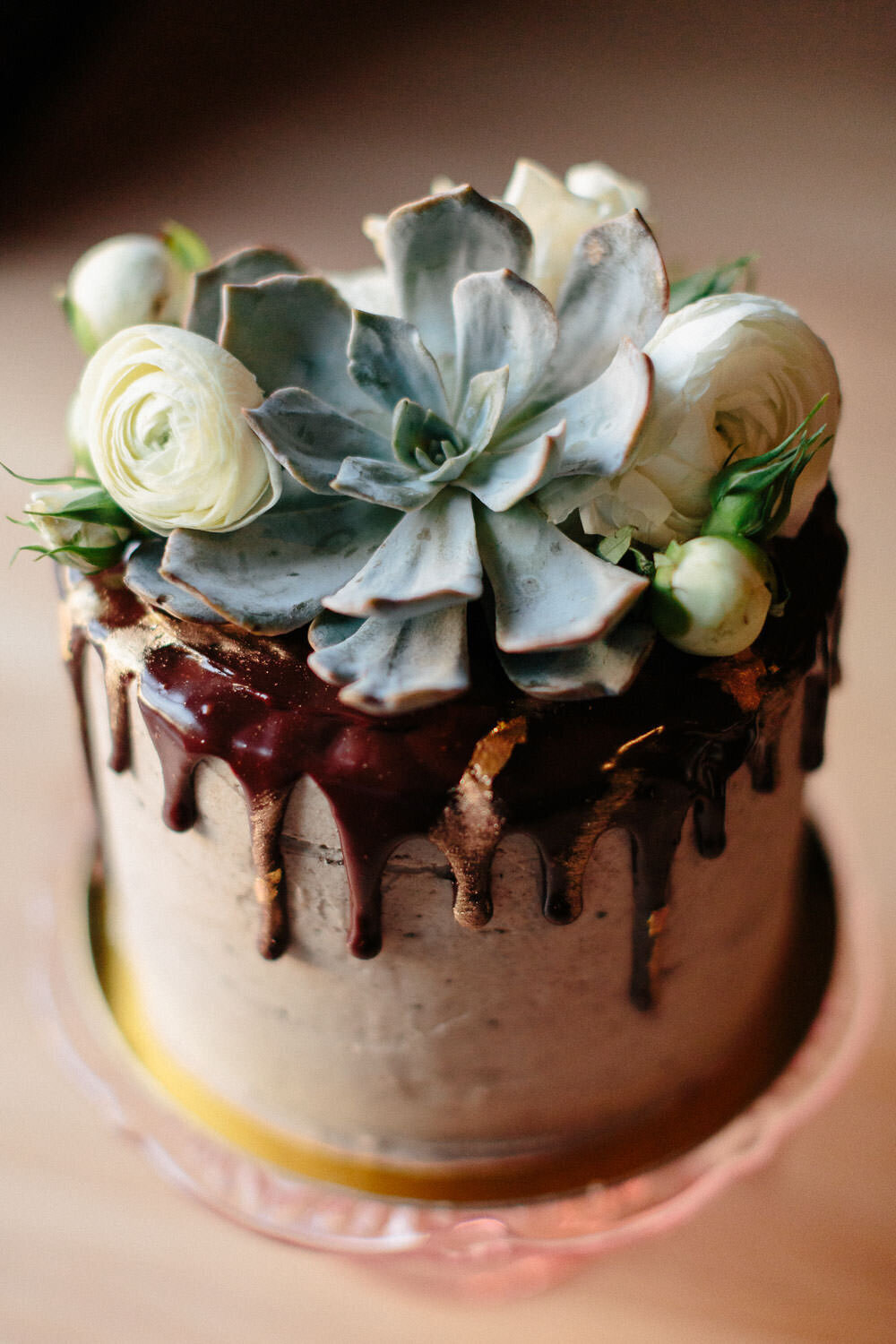 Cake with succulent at wedding reception in Houston