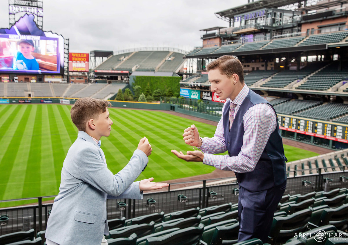 Brothers play rock paper scissors at Bar Mitzvah Party at Coors Field in Denver CO