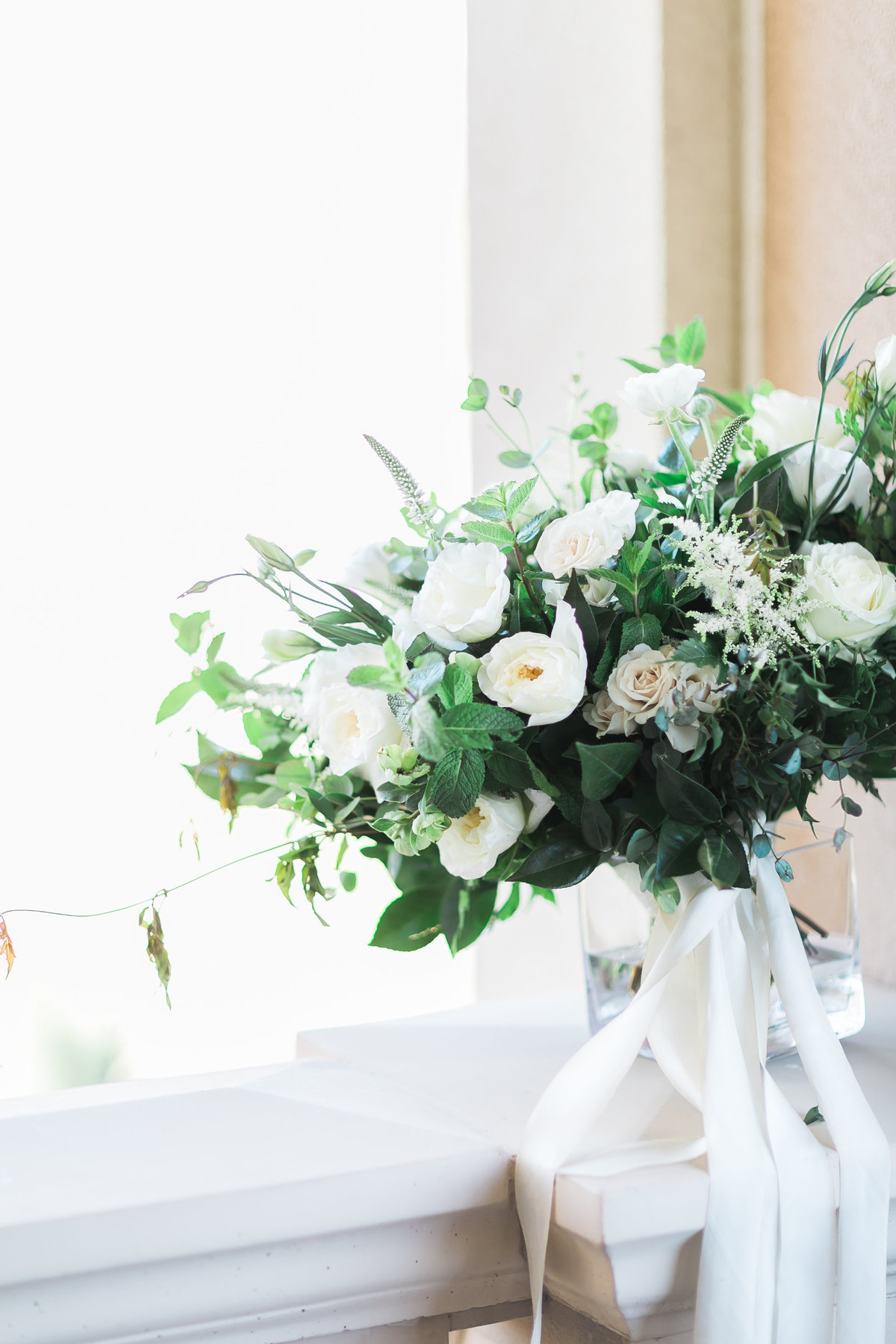 white and green bridal bouquet with silk ribbons