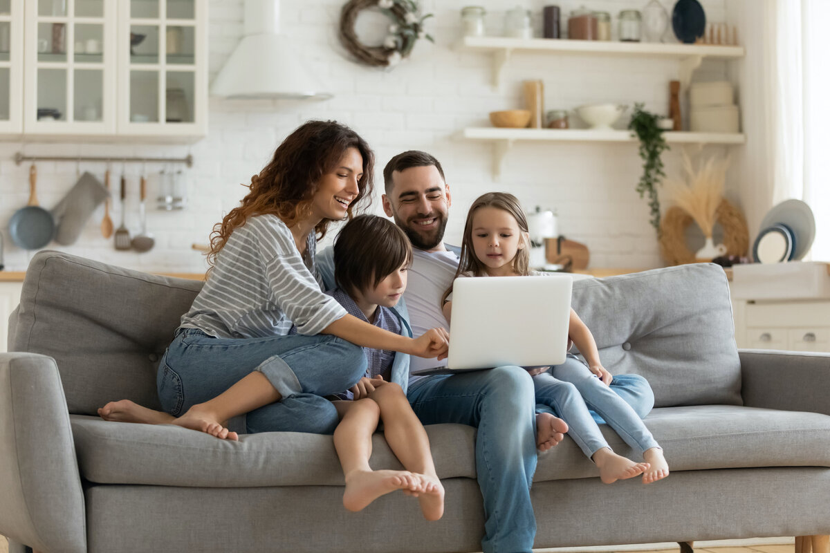 Family On Couch with Computer