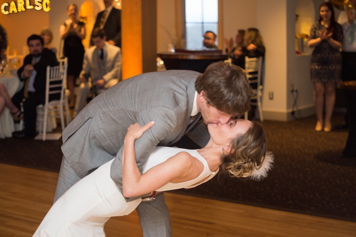 passionate wedding kiss during first dance