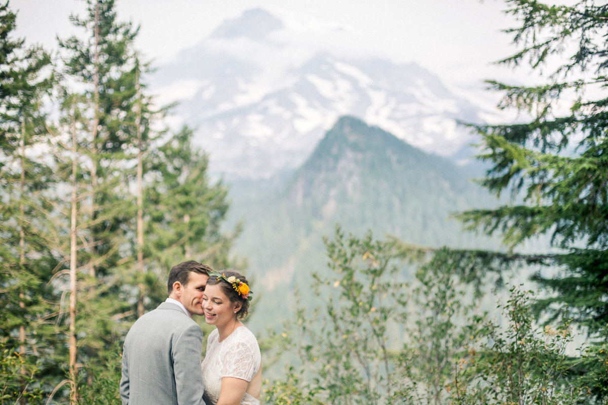 stunning couple on wedding day with mt rainier in background washington national park