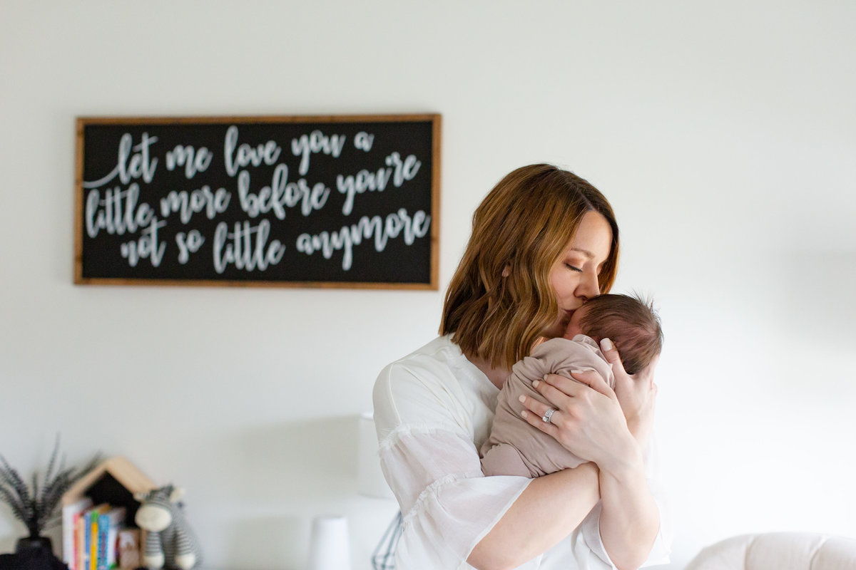 Baby boy Lifestyle Newborn  Session with mom  in nursery in St. Louis by Amy Britton Photography Photographer  in St. Louis