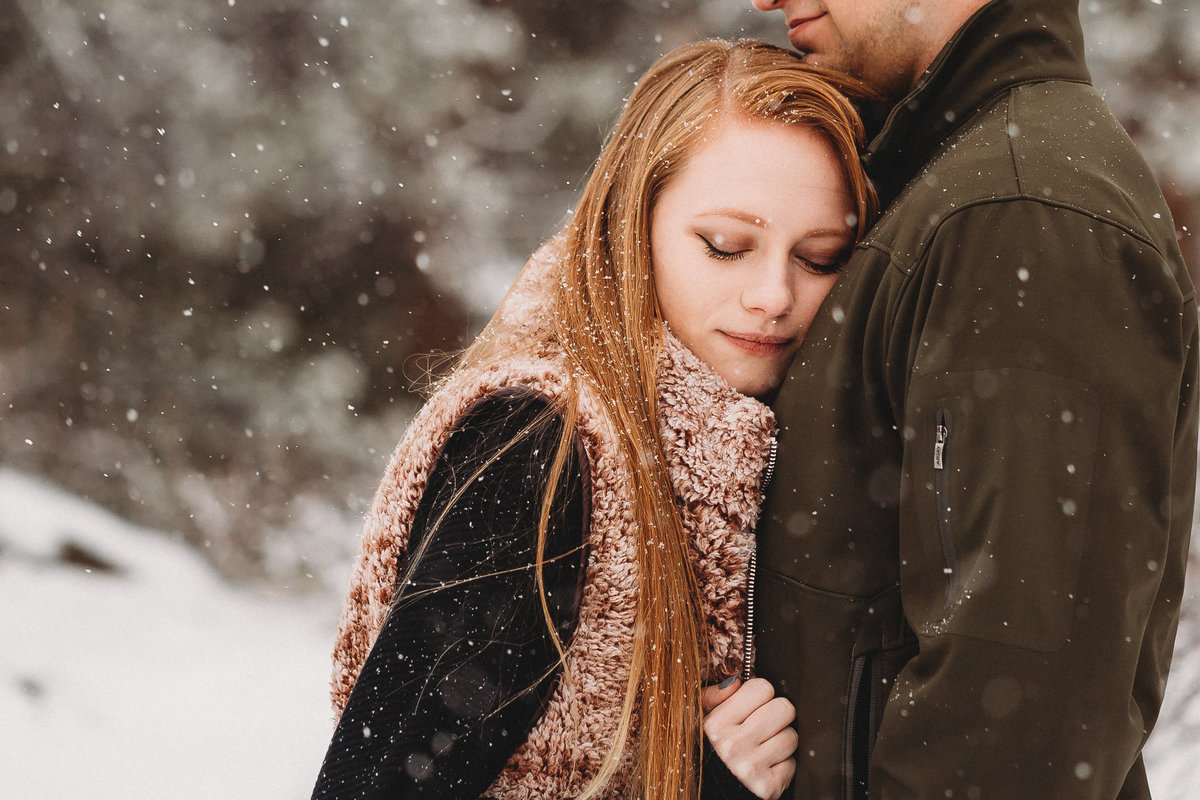 Engaged couple stays warm during snowstorm in Estes Park, Colorado