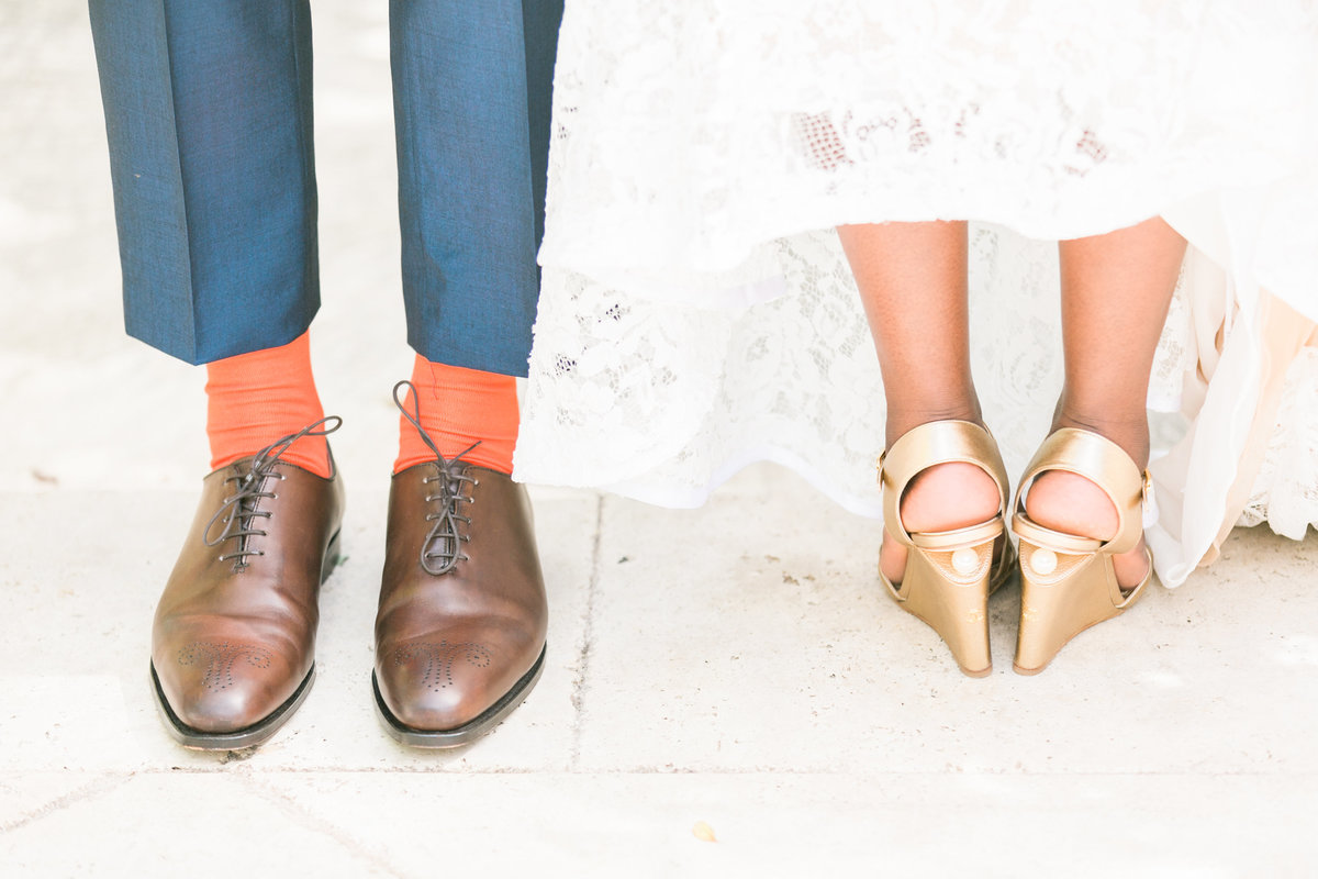 Bride's Chanel shoes and groom's Crockett & Jones' shoes