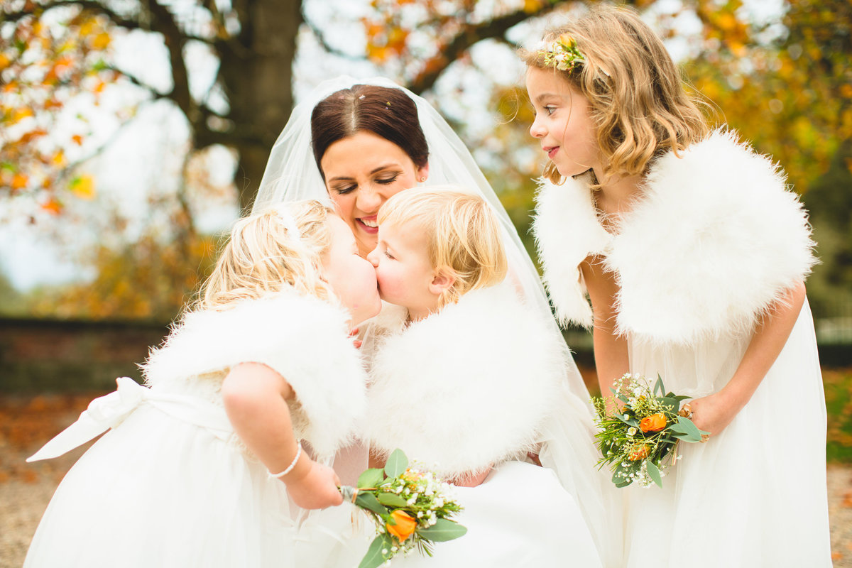 flower girls kissing each other