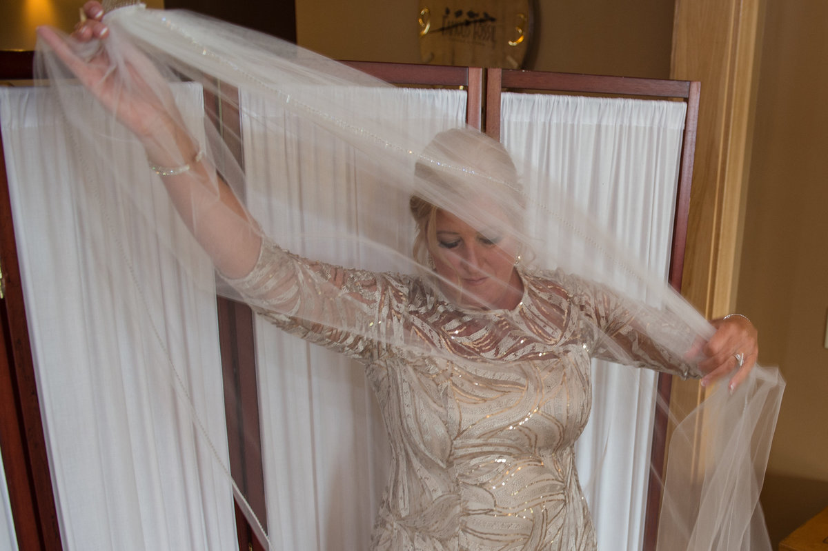 mother of bride spreads veil