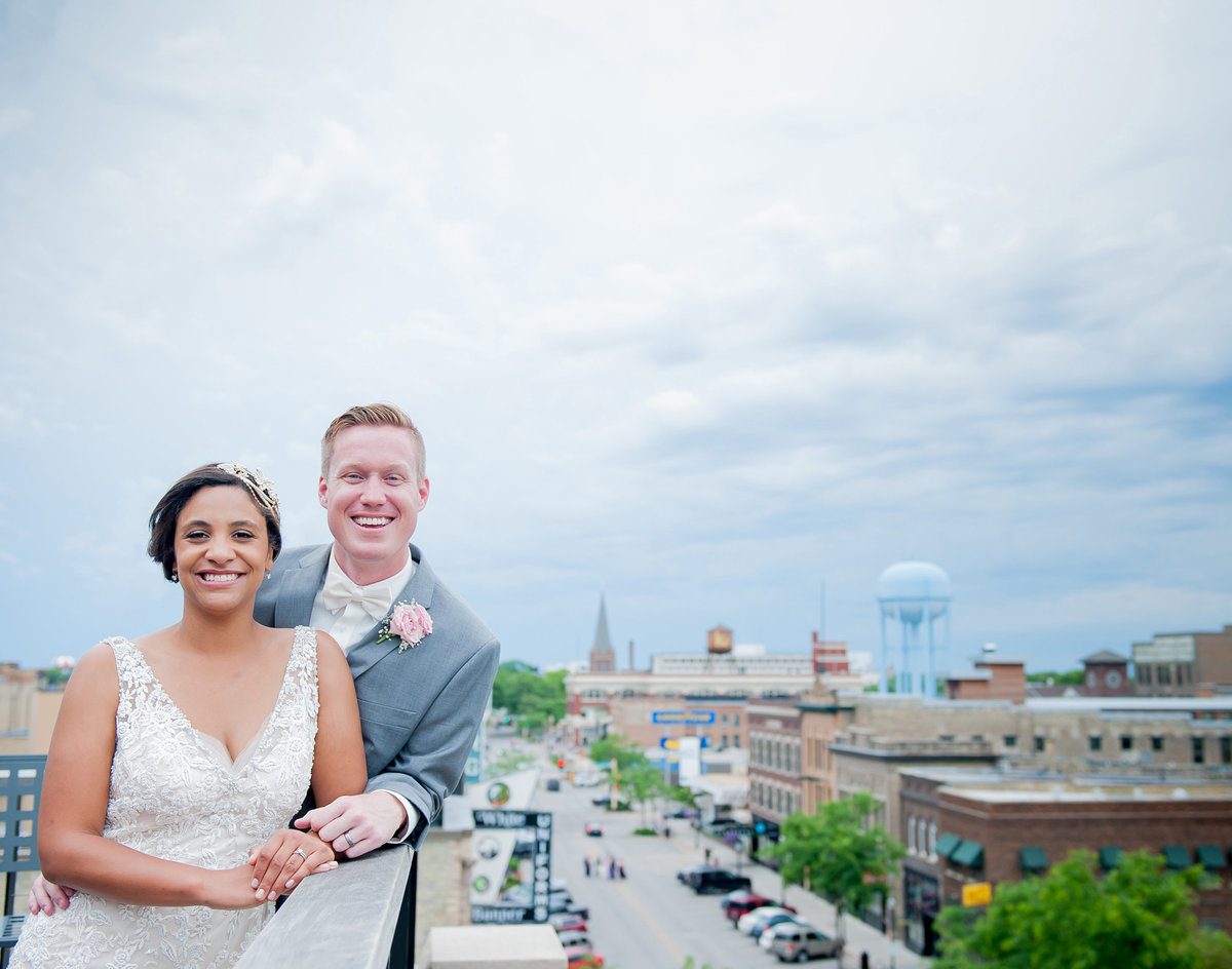 overviews of fargo, bride and groom on the rooftops. Kris Kandel the best photographer in fargo