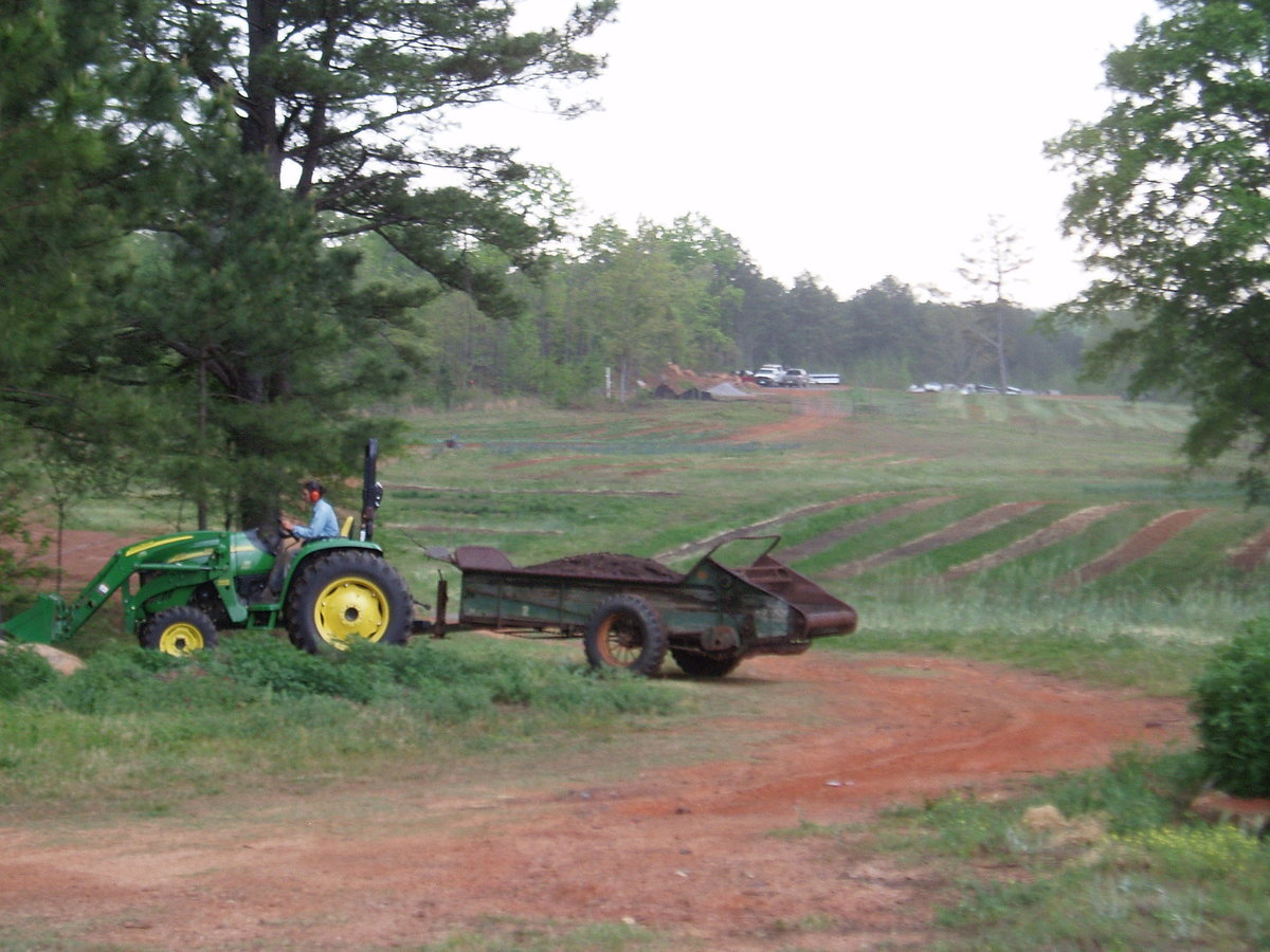 Spreading compost on the fields at Serenbe Spring 2006