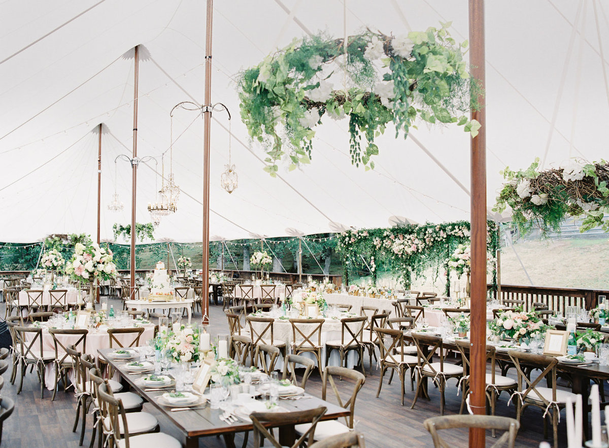 Luxury custom tent wedding with blush floral.