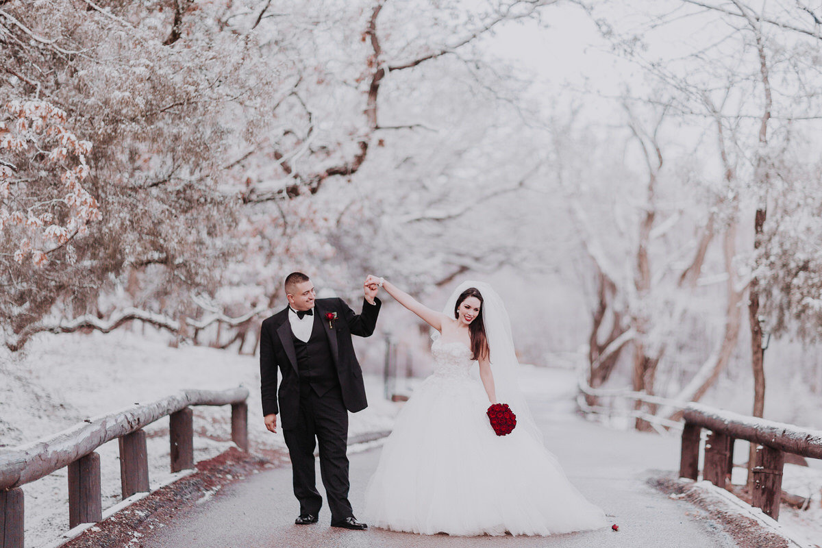 bride and groom dancing in tahoe snow