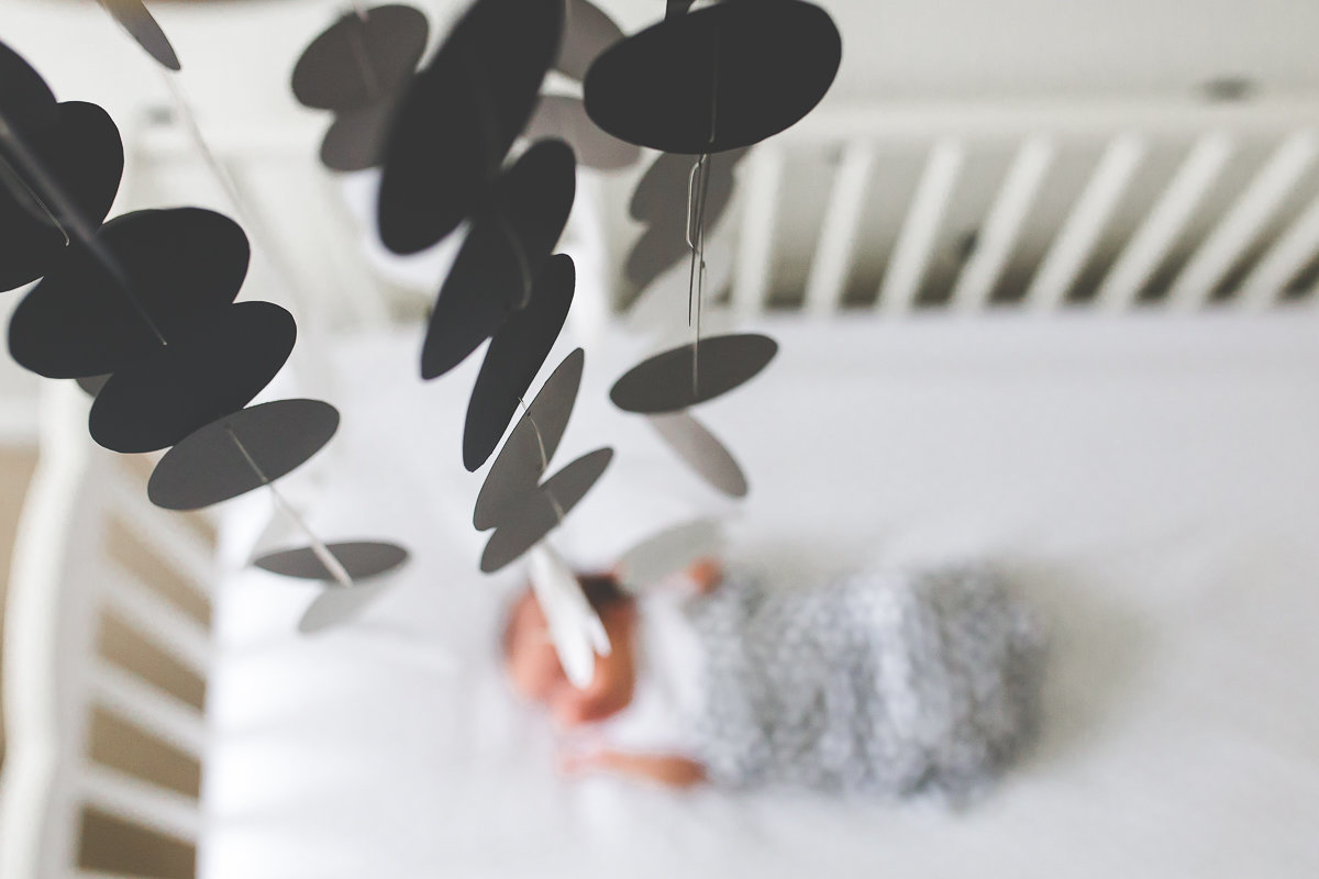 close up shot of mobile in newborn baby girl's crib {Etobicoke Lifestyle Photographer}