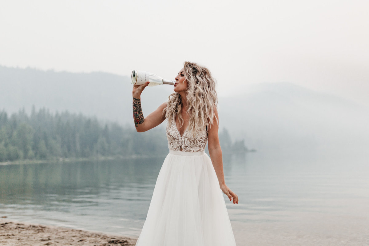 athena-and-camron-sara-truvelle-bridal-wenatchee-elopement-intimate-32-bride-drinking-champagne
