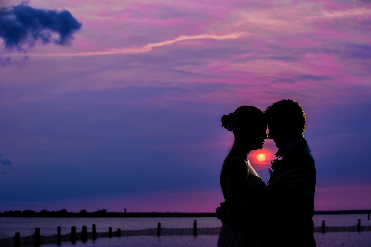 couple at sunset at the new jersey shore at portrait session