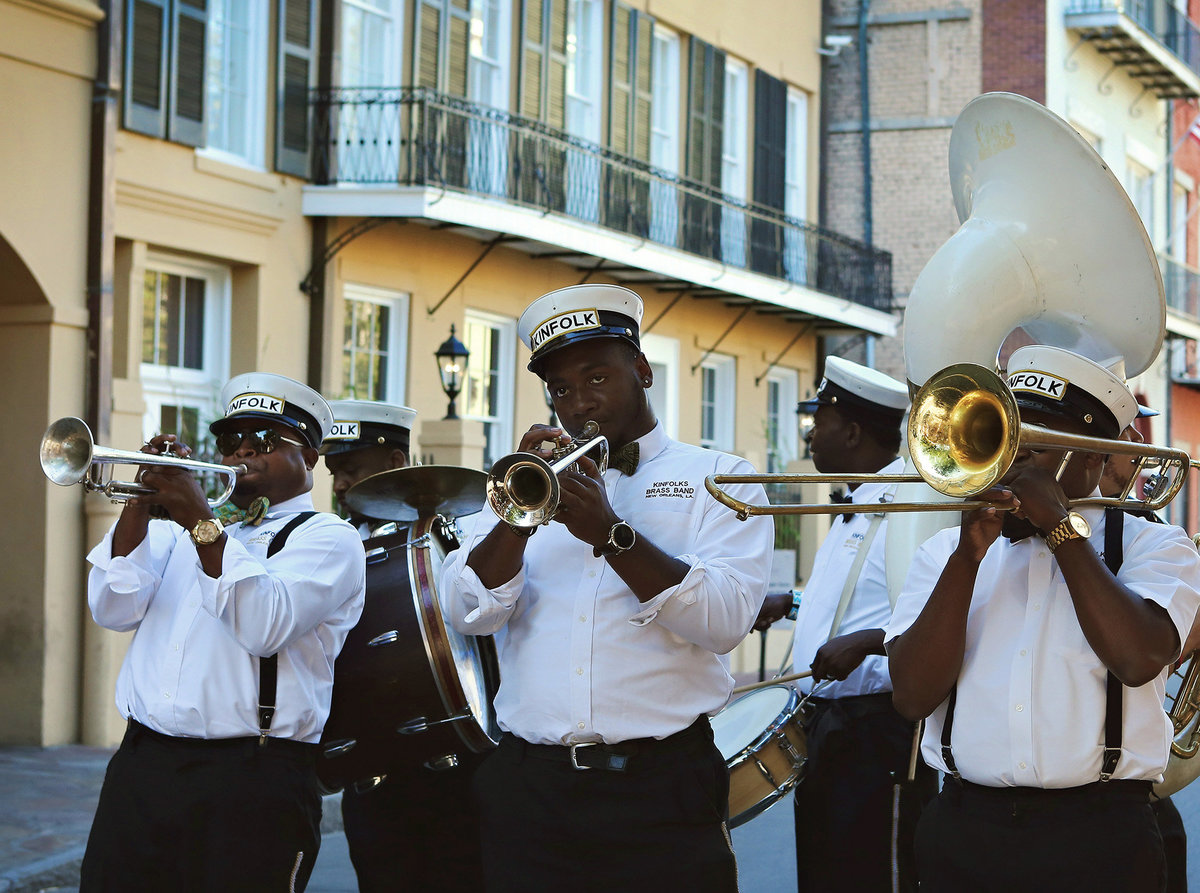 second line band in front  of Chateau LeMoyne Hotel