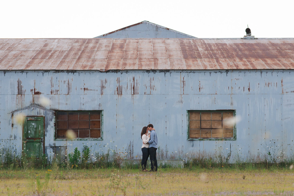couple standing together in front of old mining building