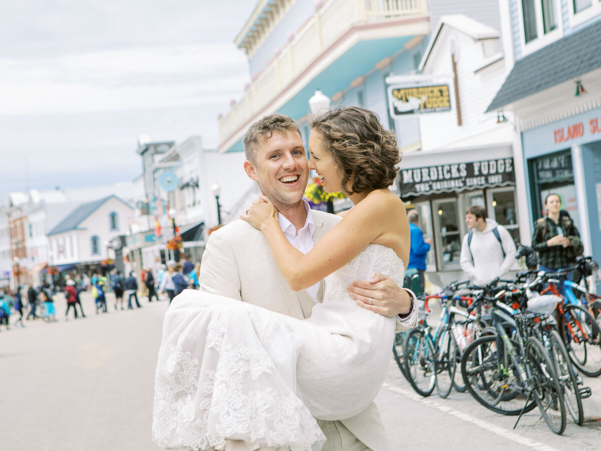 Bride and Groom walking down Main Street Mackinac