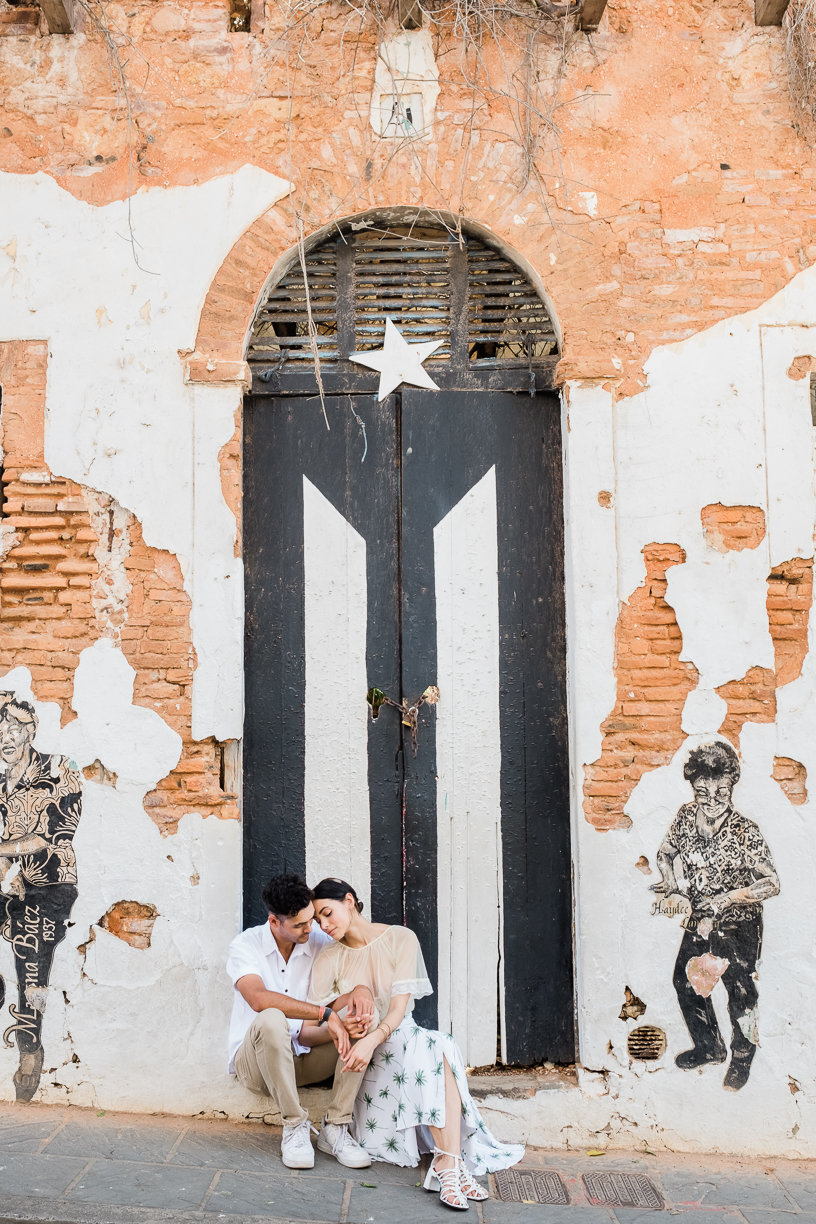 couple sitting puerto rican flag