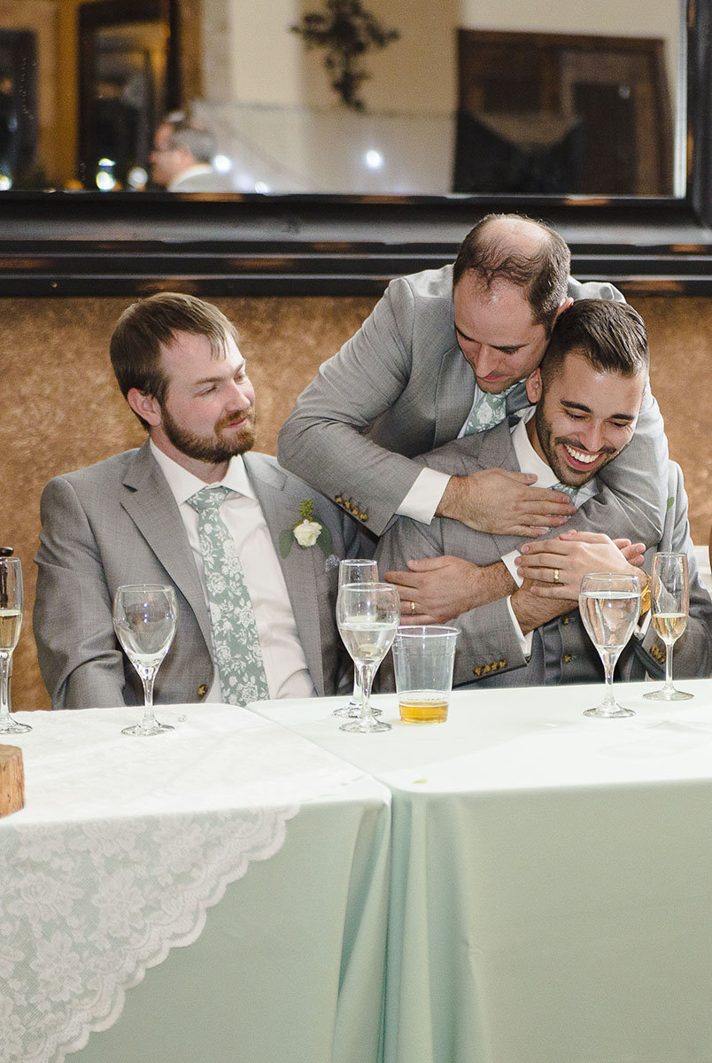 brother of groom hug during wedding speeches at superstition manor