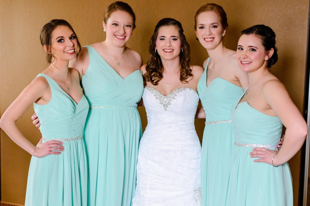 Gorgeous bride and bridesmaid getting ready during winter wedding in St. Louis