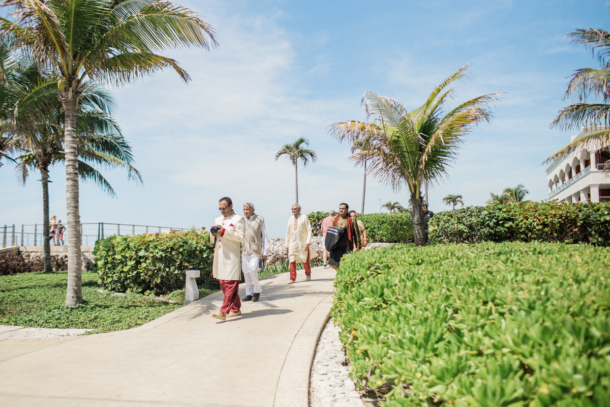 Cancun destination wedding guests make their way to the ceremony.  Photo by Rebecca Cerasani.