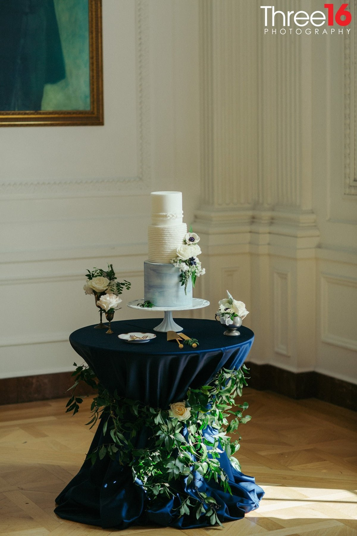 Beautiful 3-tiered white and blueish wedding cake