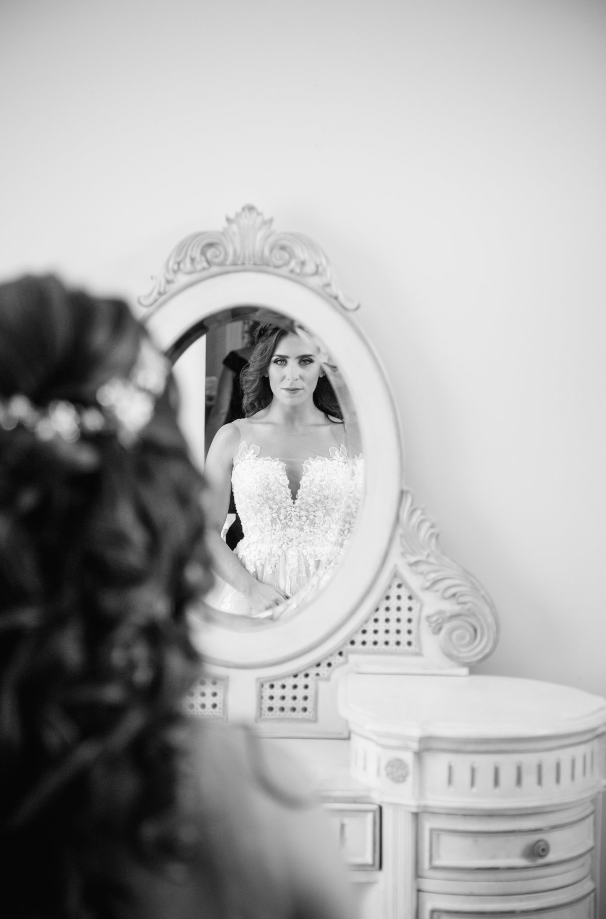 bride looking in mirror before wedding at shadowbrook at shrewsbury