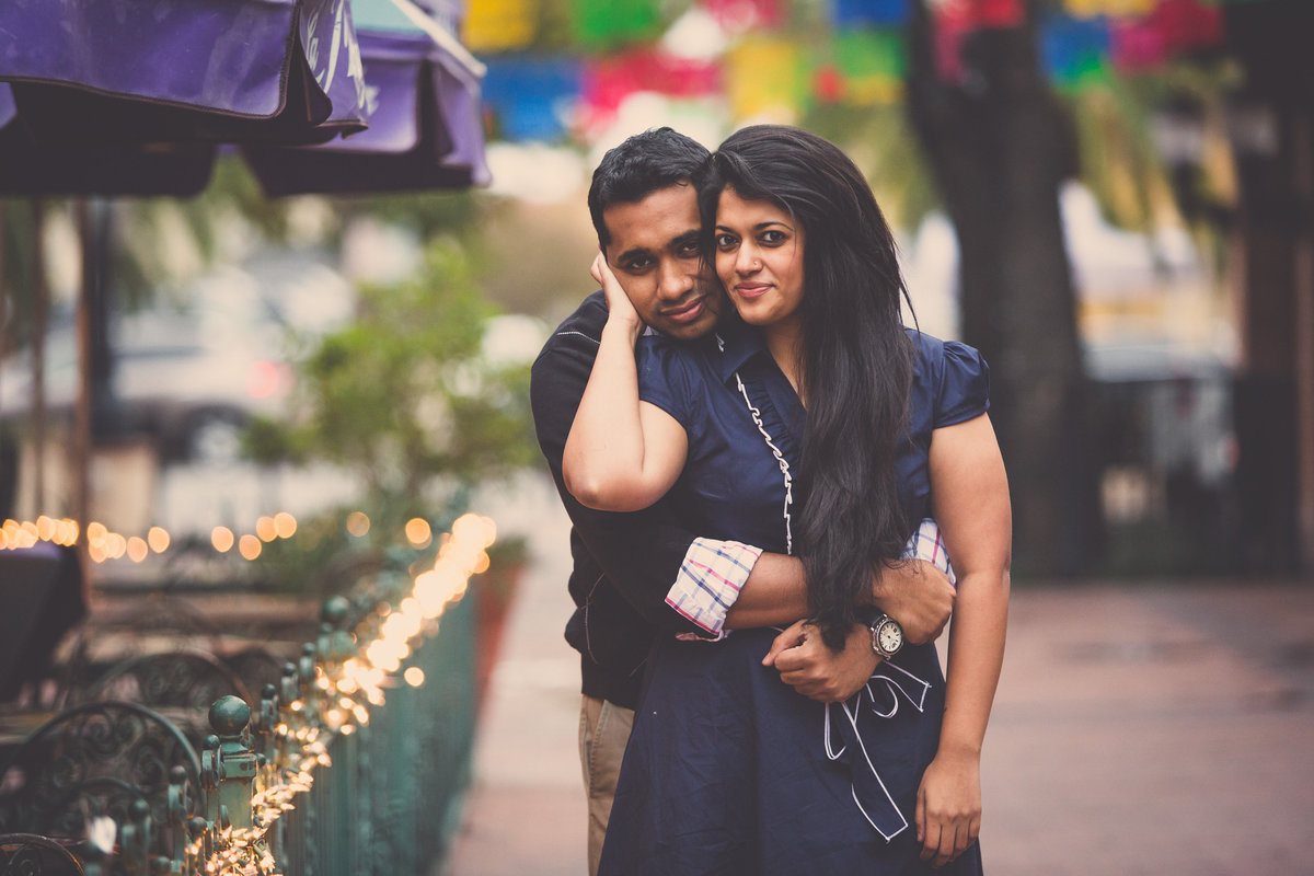 Engaged Indian couple holding each. Picture taken by San Antonio wedding photographer Expose The Heart Photography.