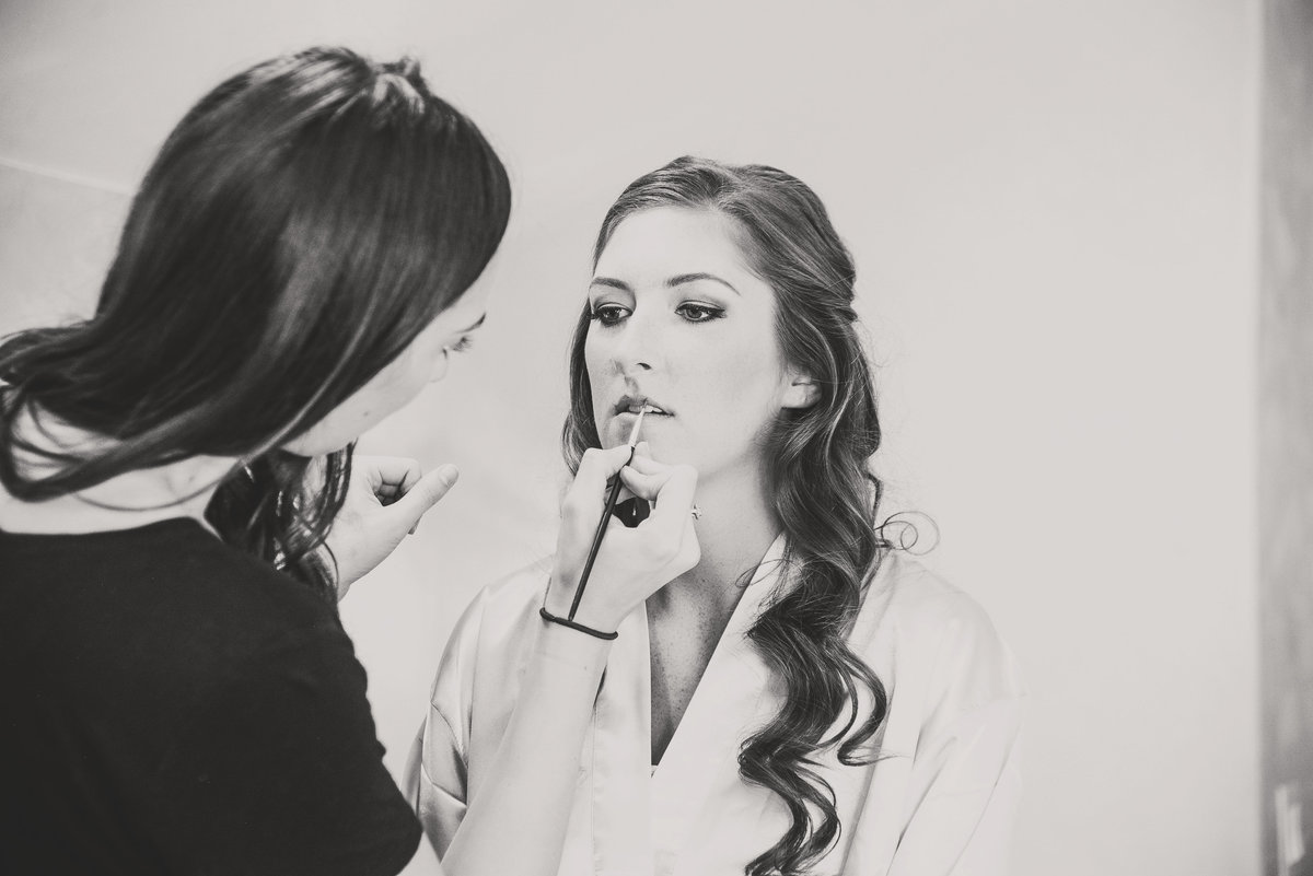 bride getting ready with makeup artist