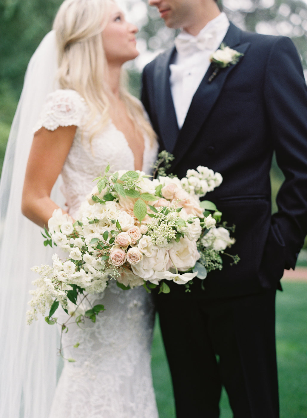 Luxury Bridal Bouquet using blush dahlias, fairy roses, and false spirea.
